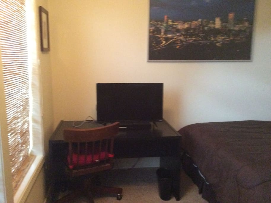 Desk with TV and DVD player.