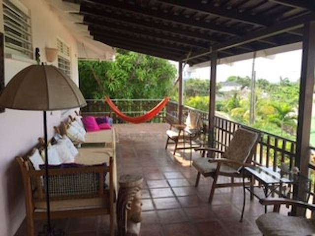 the verandah that is offering everything you could possibly need. Including sea views.