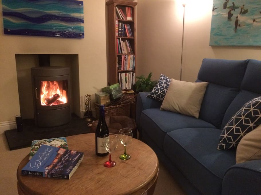 Curl up by the fire in the cosy lounge