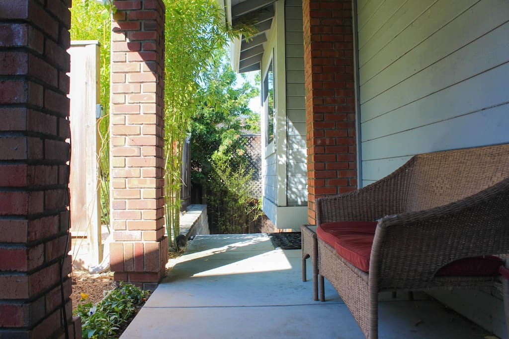 Sidewalk to guest entrance on the side of the house