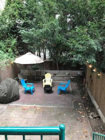Brownstone Apartment with Private Backyard