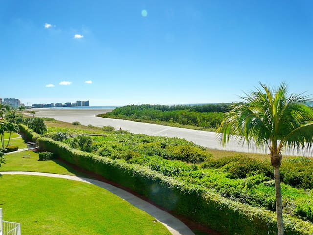Beachfront condo w/ heated pool & wraparound balcony w/ unmatched views