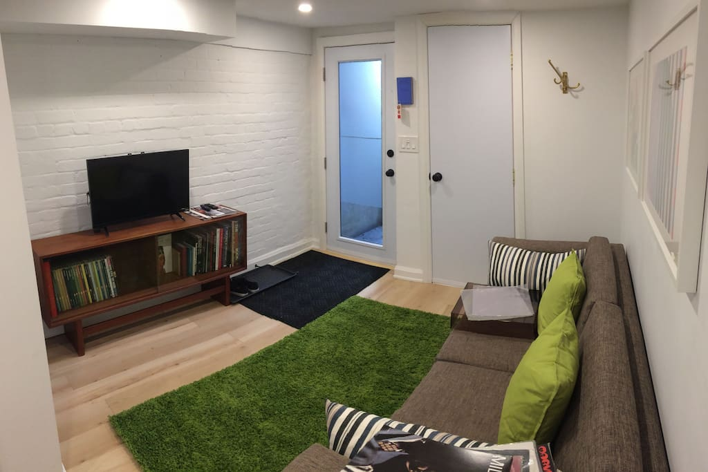 living room with modern decor, comfy but stylish couch and android box on the flat screen