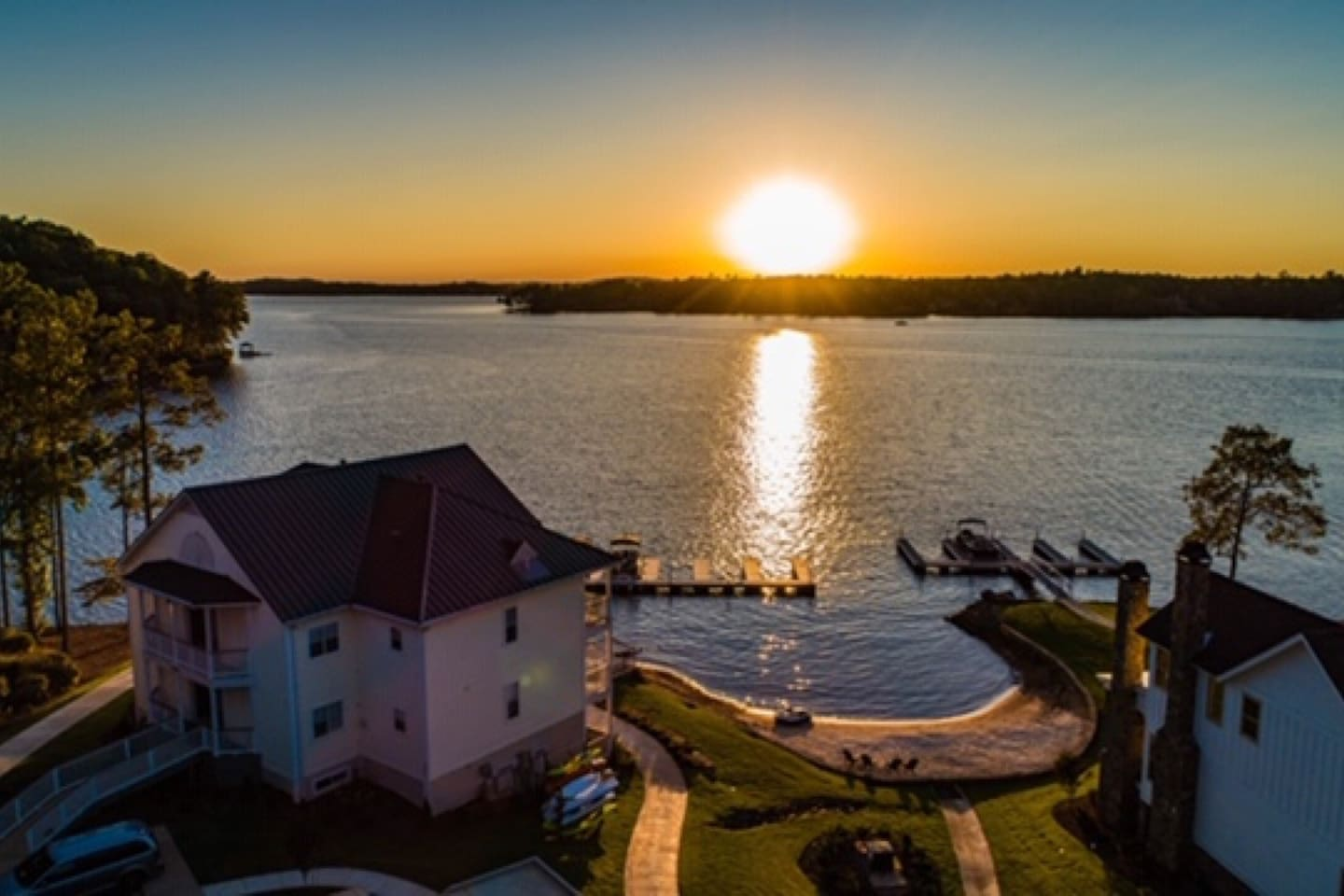 Resort-style complex with Penthouse condo overlooking private pool, lake, beach, pier, and boat docks.  Spectacular sunsets from your 2 balconies.