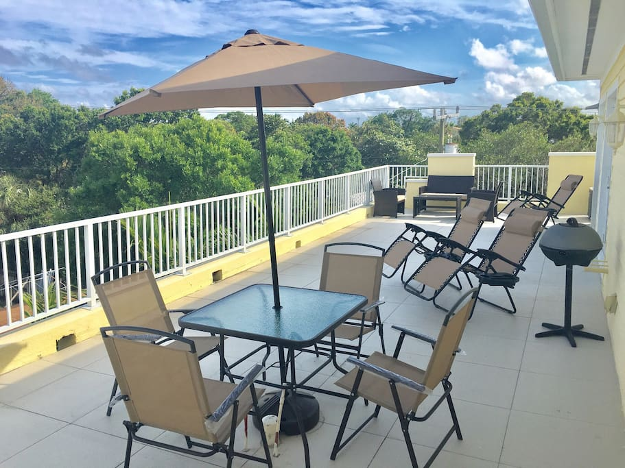 Large terrace that is shared by guests with great views of downtown Fort Lauderdale to enjoy a beautiful sunset after a beach day.