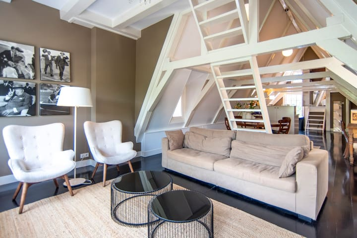 Loft accommodation in a monumental canal house.