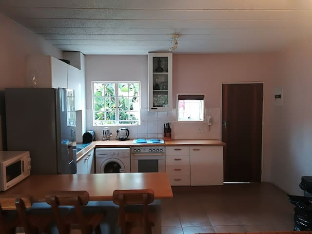 Kitchen fully equiped with washing machine, fridge, oven, microwave and stove