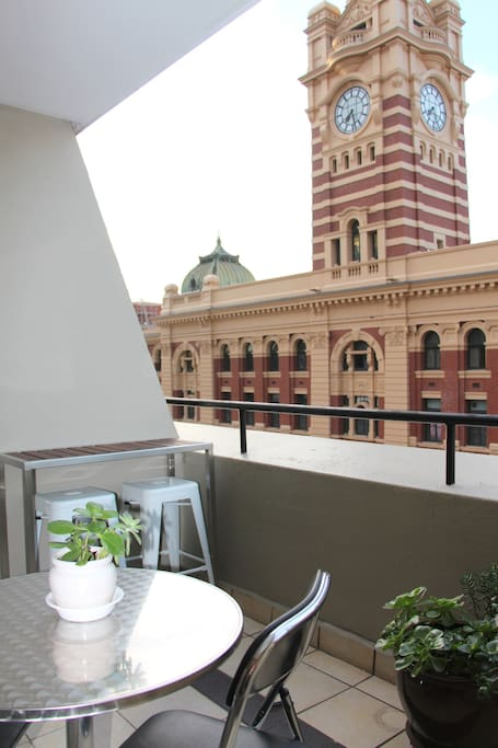 Balcony view of Flinders St Station clock tower.