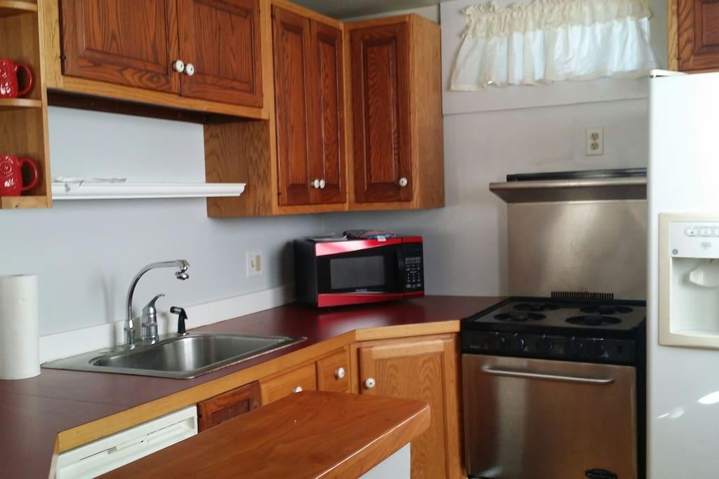Gas stove, microwave,  garbage disposal, dishwasher & refrigerator