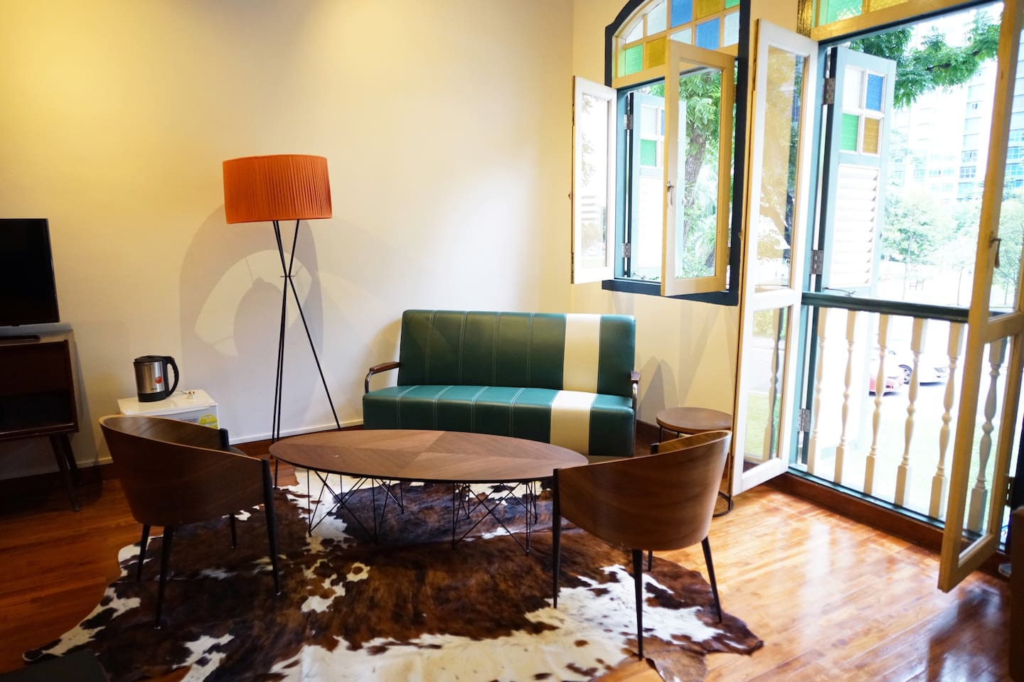 Our laidback lounge seater area complete with a mini-fridge for ice cold drinks and casual chilling by the large patio windows..