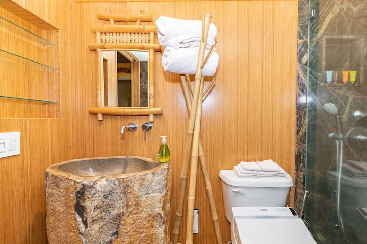 Bathroom features a one-of-a-kind carved stone sink