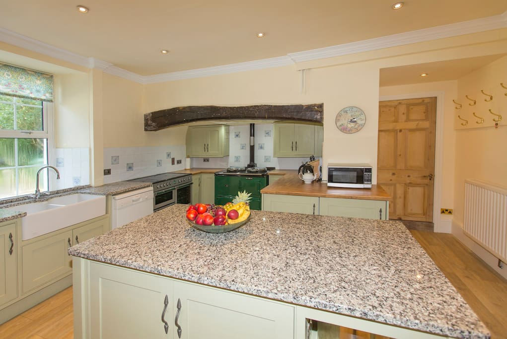 The kitchen area includes an American fridge/freezer, electric double cooker, an aga for winter.