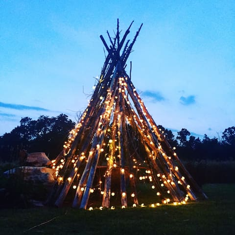 teepee in the backyard, beautiful at night
