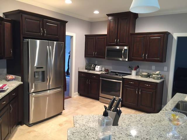 Full access to the kitchen with all new appliances- stove top with oven, Coffee maker, microwave. Refugees room for groceries or can use the smaller frig upstairs.
