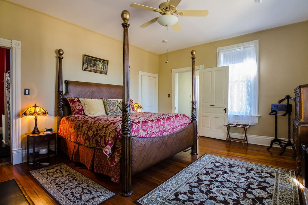 The Magnolia Suite features antique furnishings and four-poster bed