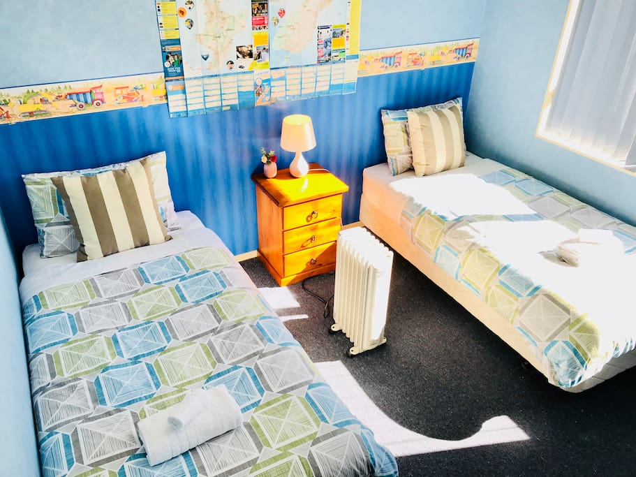 Room 1 has two brand new single beds. It's sunny and warm.