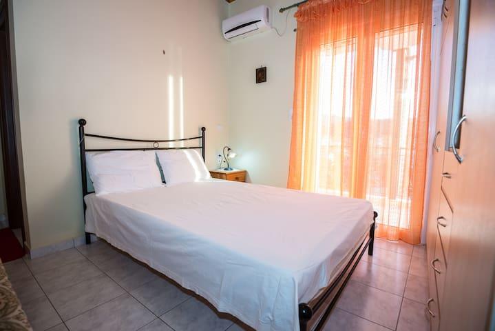 Bedroom with spacious closet, air-condition, tv & sofa!