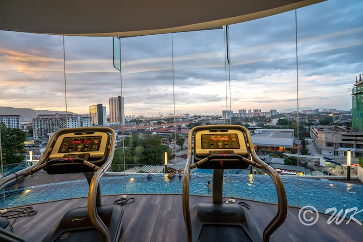 Gym with pool view