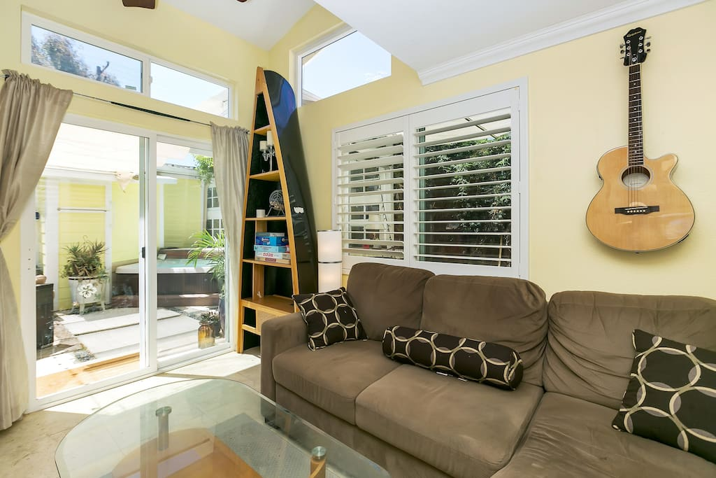 Relax on the plush sofa in the living room. Enjoy tons of natural light from all of the windows.