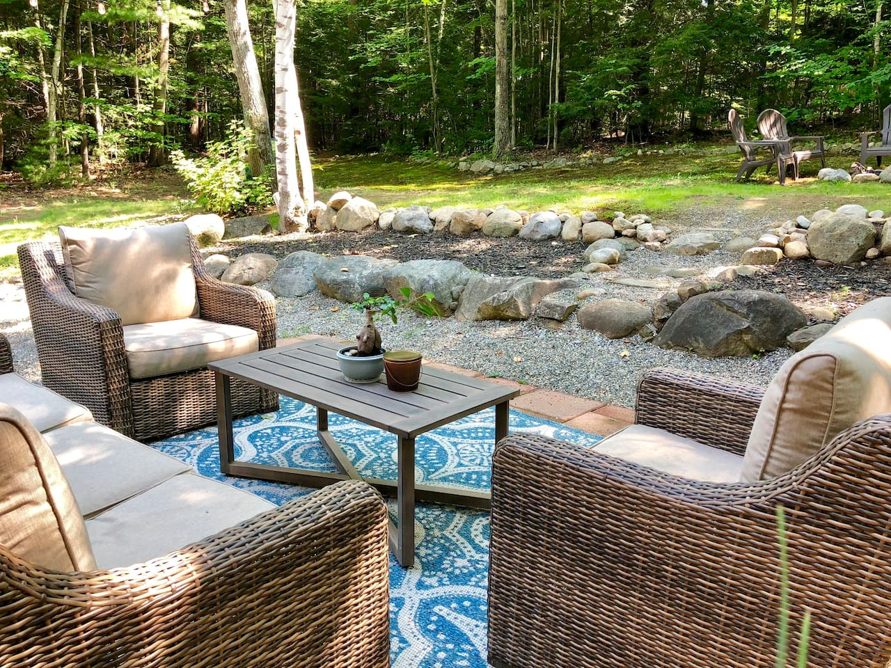 Backyard oasis complete with comfortable seating, bonfire pit, grill, patio dining and hammock.  Outdoor will be removed for the season in November, weather permitting.