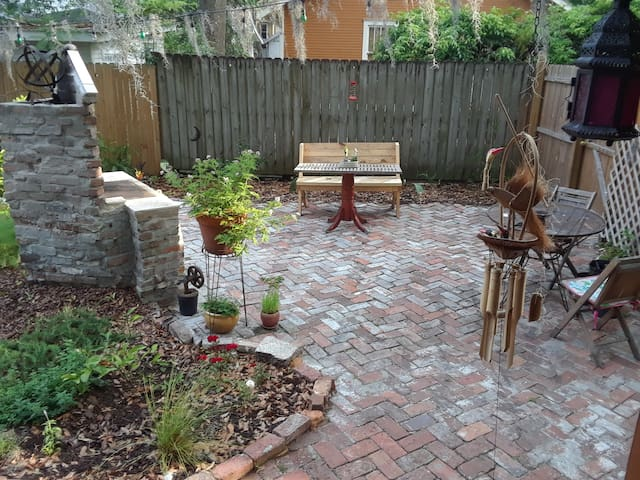 Back yard, fireplace, and wood burning grill.
