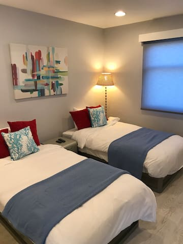 2nd Bedroom has 2 Twin Beds which can convert to King.