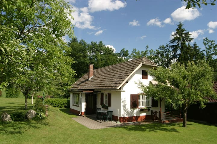 Nice white bungalow, located in sunny nature setting.