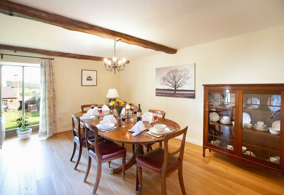 The Dining Room at Elk Cottage has French doors that open out onto a lawned area.