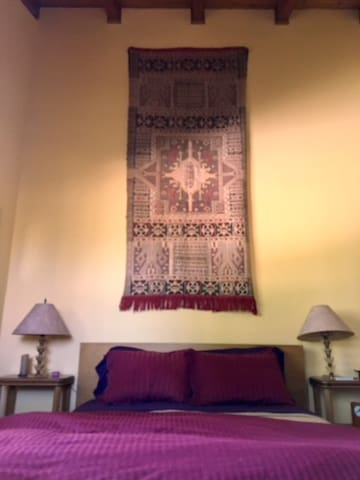 Open beam ceiling. The comforter is red, not pink. :-)