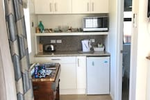 Kitchenette with butcher block for extra bench space.