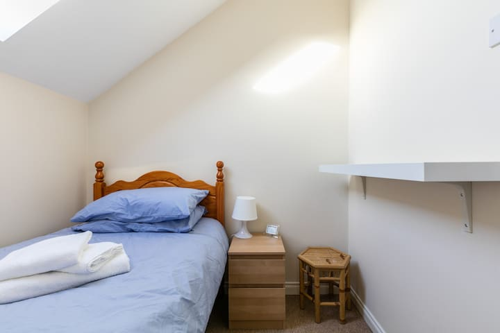 Small loft room in townhouse near city centre