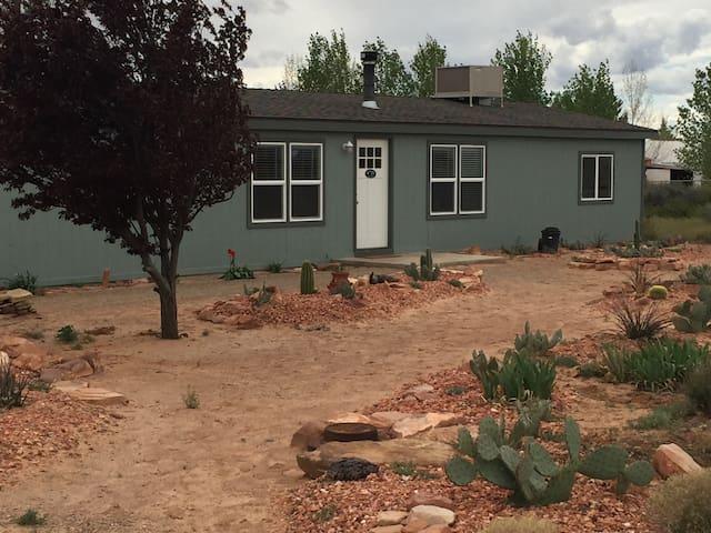 Front entrance and cactus islands garden