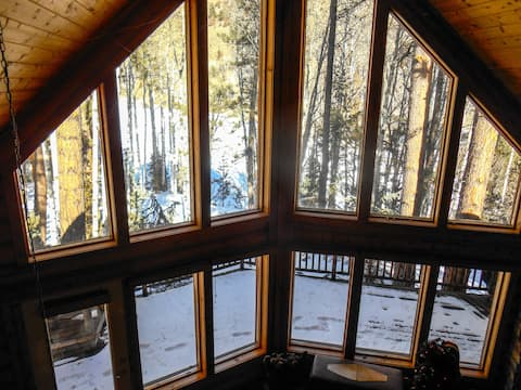 SECLUDED A FRAME CABIN, SURROUNDED BY PINES/ASPEN