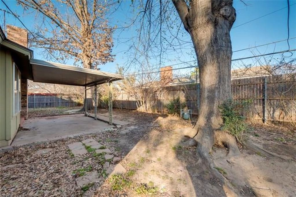 Spacious backyard with covered patio for entertaining. We have table and 2 folding chairs.