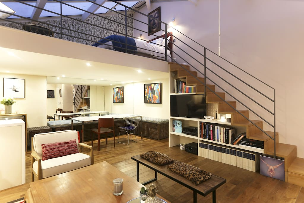 """The living with the """"library stairs"""" to go to the bedroom"""
