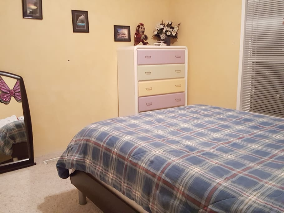 Guest bedroom has 2 nightstands, a dresser and closet space available.