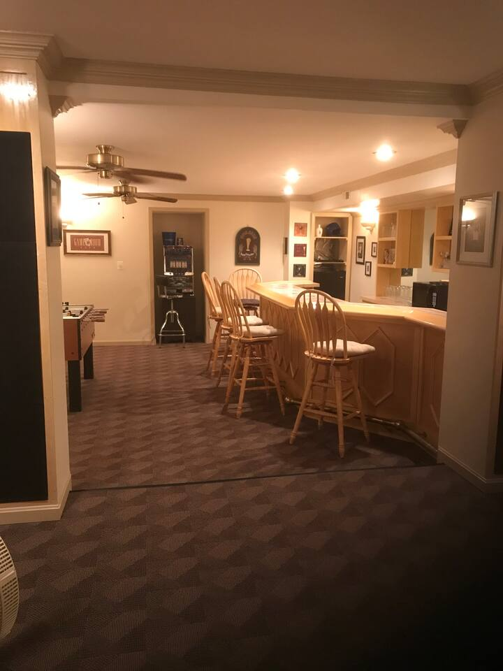 Large Fully Furnished Basement, great for entertaining or for the family to relax after a day of adventure. Bar comes equipped with fridge,microwave and full sink.