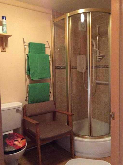 Power shower with extractor fan. One towel per person provided.