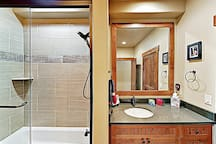 The en-suite guest bathroom has a tub/shower combination and is also accessible via the hallway.
