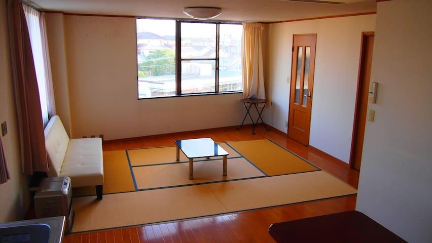 近くには海が。トレーニングジムのある眺めの良いお部屋です。 - Fukutsu-shi
