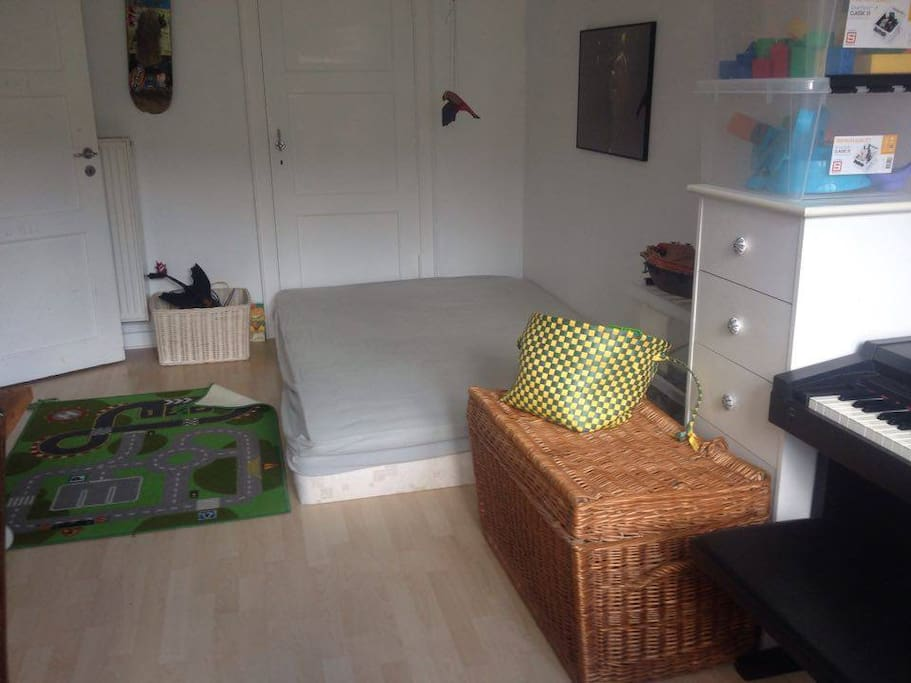 2. bedroom - one doublebed, also a desk, lots of toys and childrens books, and a electric piano.
