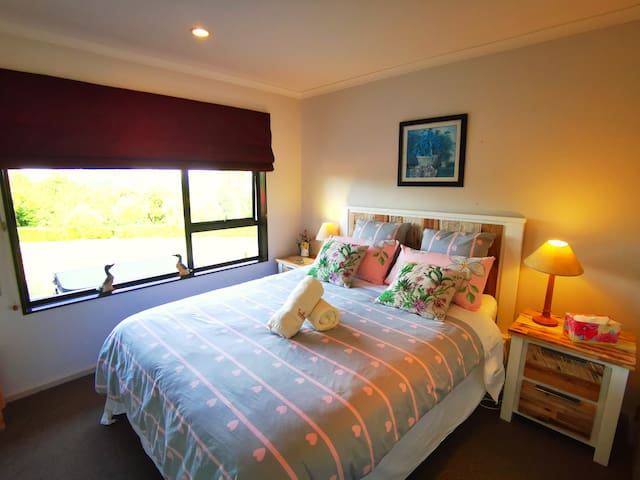 A warm bedroom with garden view