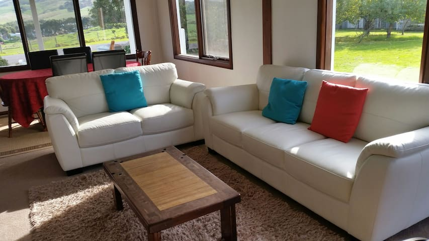 cosy lounge room with beautiful  sunfilled windows