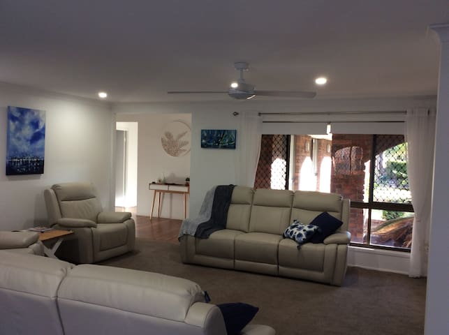 Formal lounge with 6 electric recliners