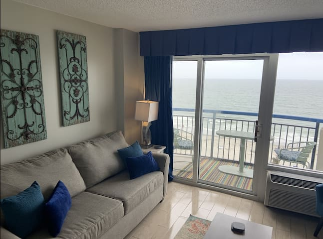 Gorgeous views from the 9th floor.  Tastefully decorated living room with extra chairs and large sofa bed.