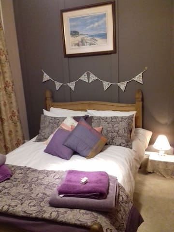 """Guest room 2. Cosy double bedroom with towels and """"Love from Shetland"""" soap."""
