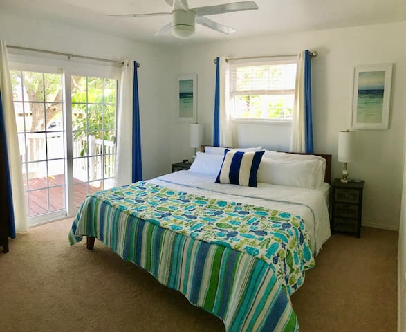 Bedroom 2 (master) -- furnished with a king-size, memory foam mattress with adjoining bathroom and sliding door access to the balcony