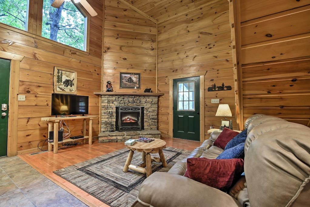 Vaulted ceilings and nature decor set the rustic tone of this cabin in the woods.