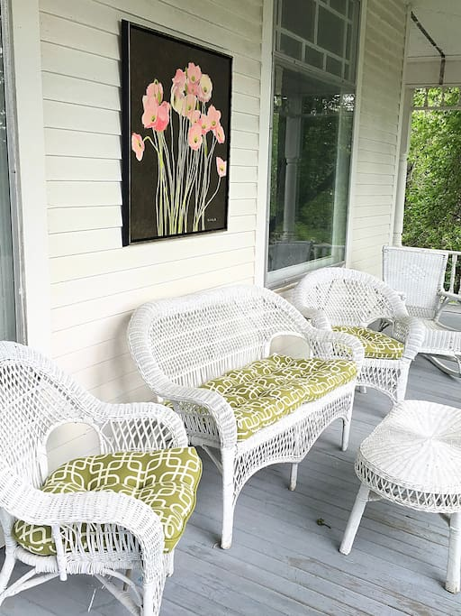 Relax on the comfy wicker furniture on the wrap-around porch.