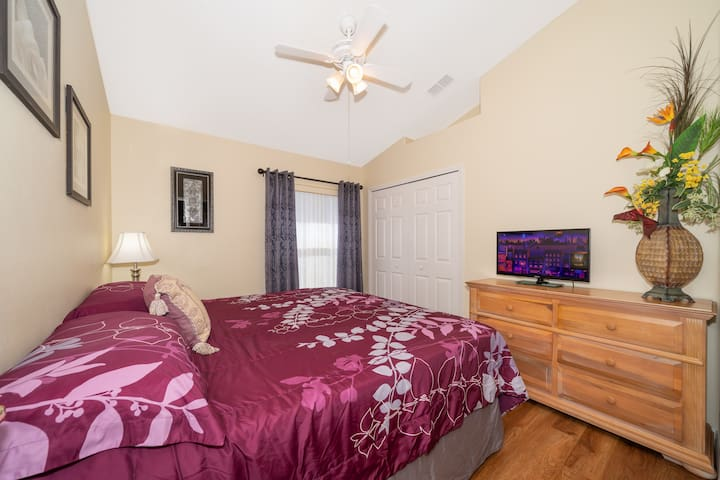 Second King Size Master Suite with ROKU Apps on LED TV, private bathroom. And ceiling fan